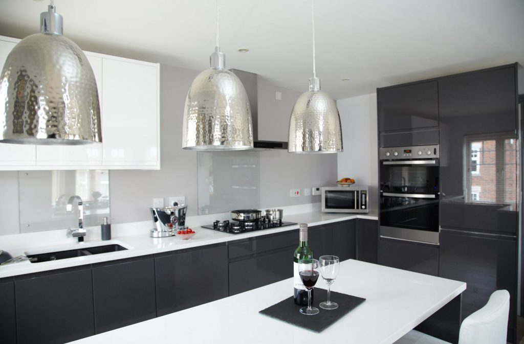amazing two tone black and white kitchen with high gloss kitchen cabinets - kitchen renovation cost