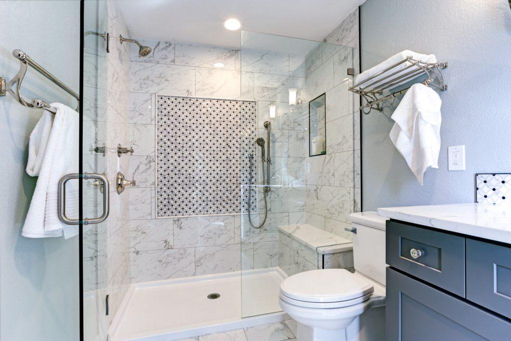 custom bathroom with walk in shower and blue vanity - bathroom renovation cost