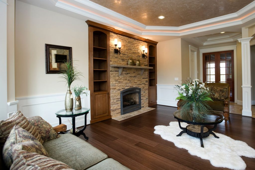 modern family room with backlit ceiling and wainscoting wall trim