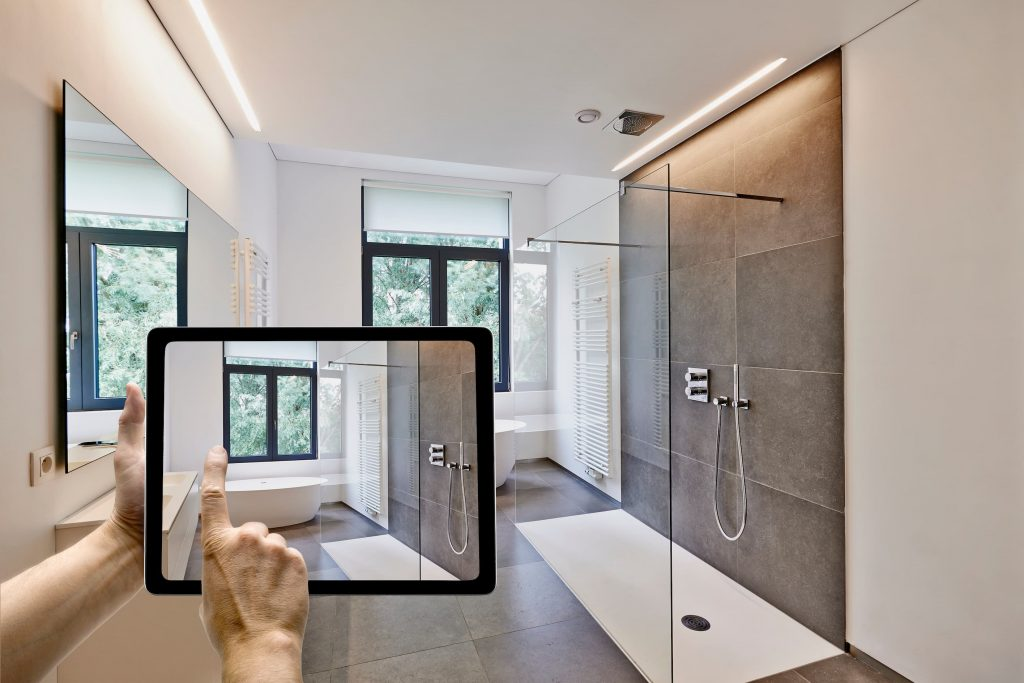 photo of a man taking picture of new finished bathroom with his ipad - bathroom renovations