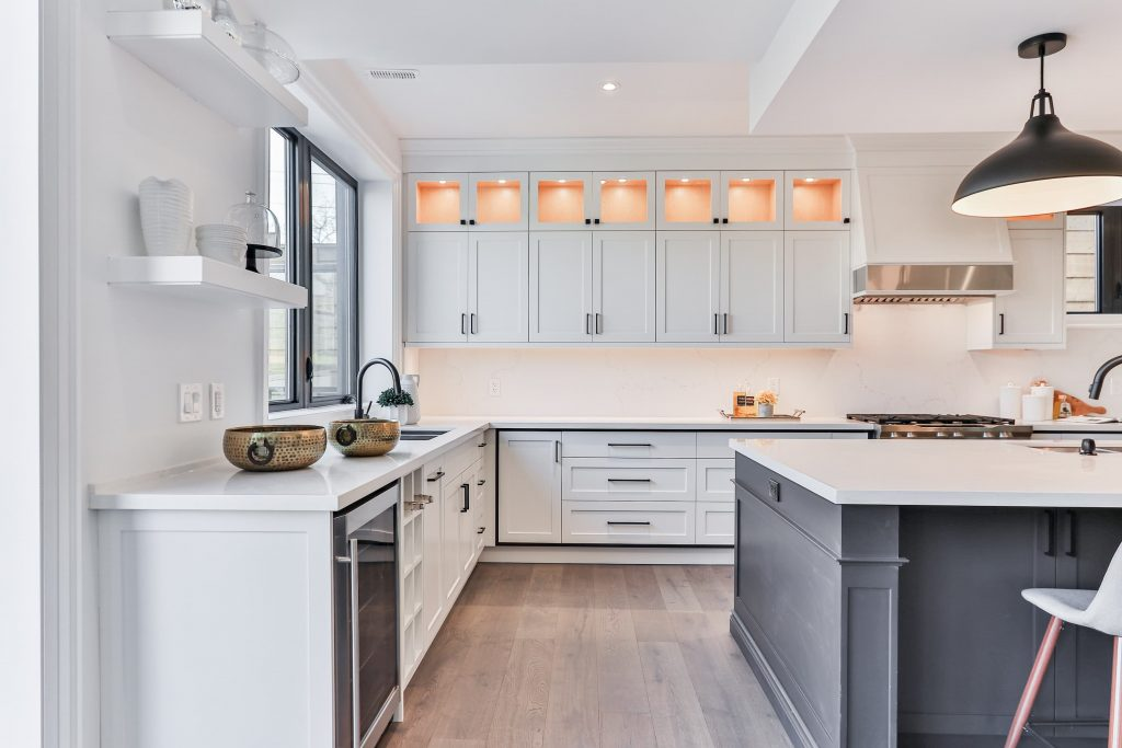 luxury kitchen with backlit kitchen cabinets and build in appliances - kitchen renovation cost
