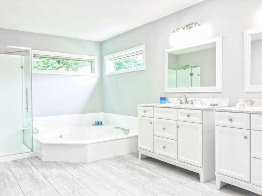 modern bathroom with custom bathtub and walk in shower - bathroom renovations