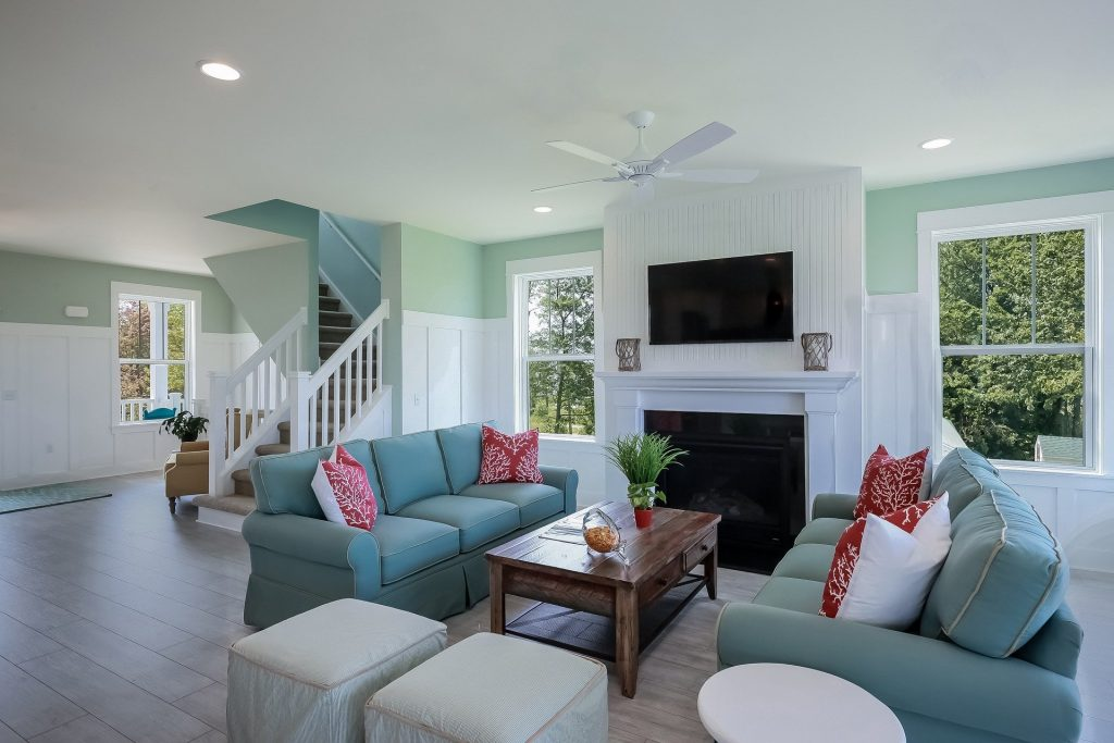 modern living room with green wall painting and wainscoting wall cover