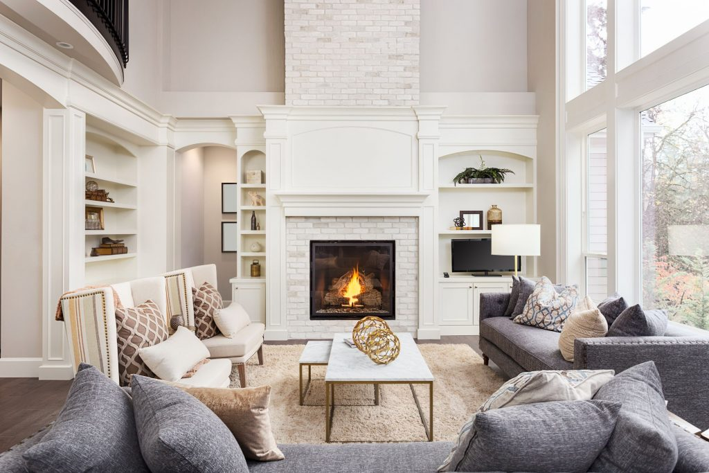 classic living room with build in fire place and crown moulding trim