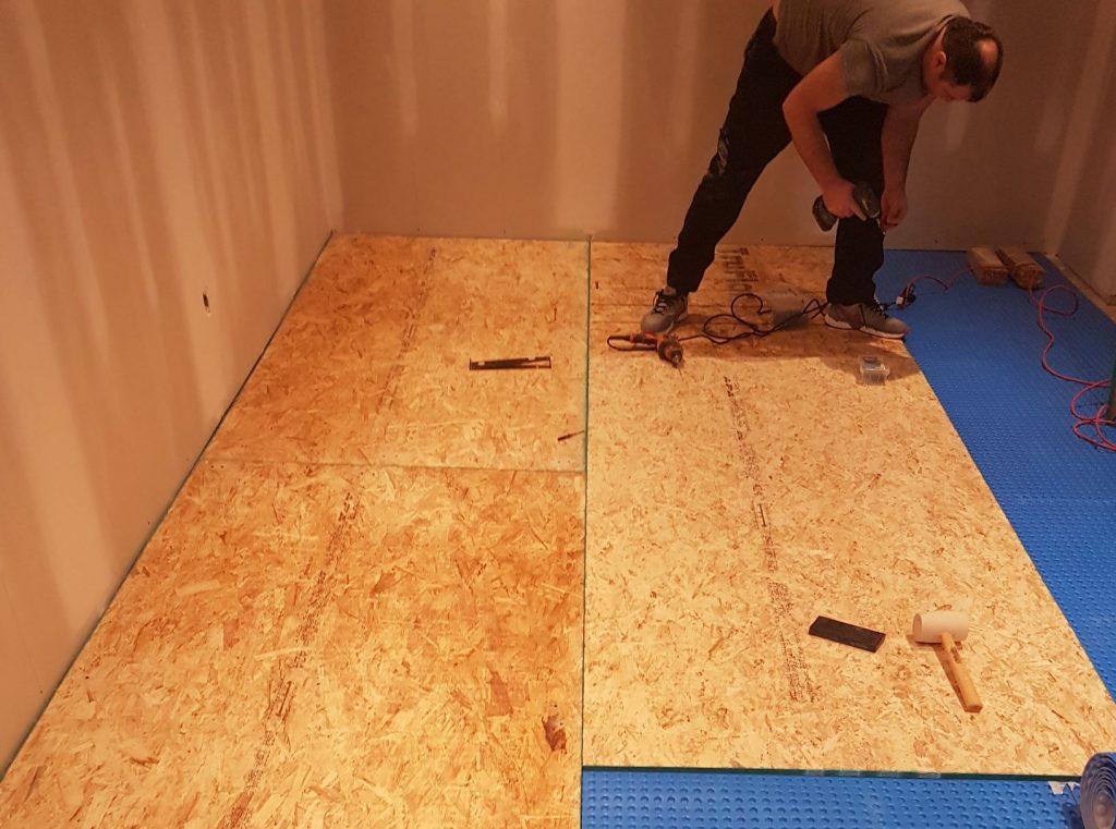 our team installing floor - flooring contractors