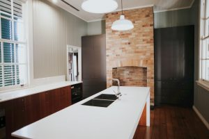 clasic kitchen with build in fireplace and double sink - kitchen renovation cost
