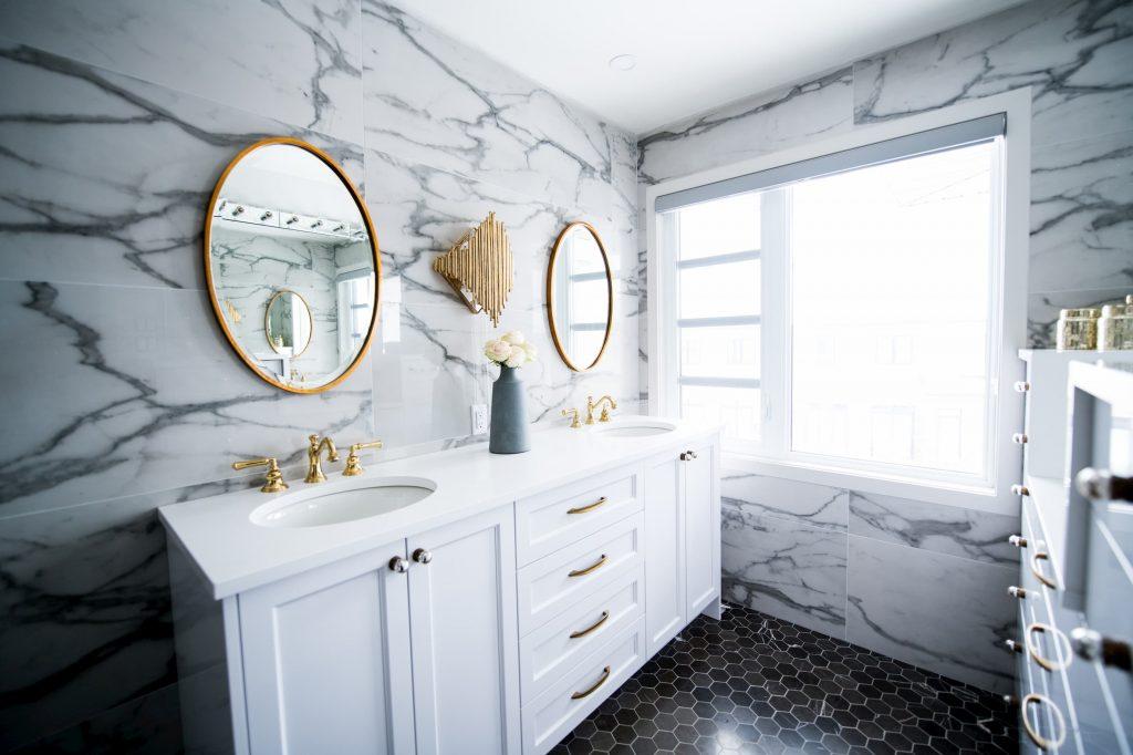 custom bathroom with marble wall tiles and double vanity - bathroom renovations toronto